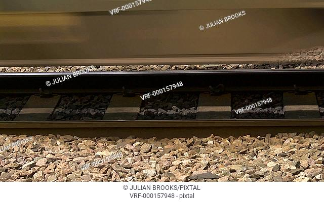 Close up of seamless loop of train wheels passing along a railway line
