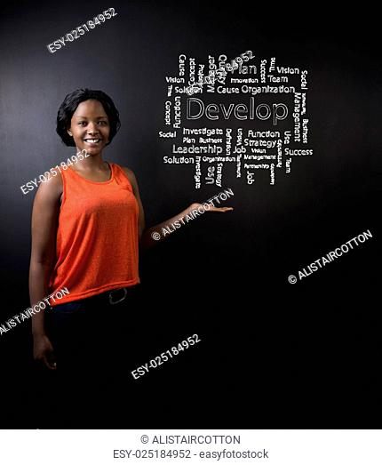 South African or African American woman teacher or student against blackboard develop diagram