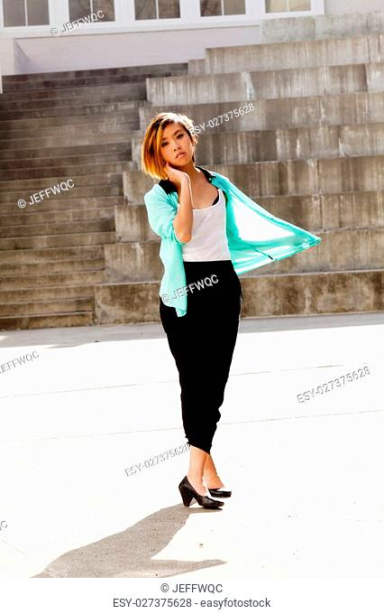 Skinny Asian American Woman Standing Pants And Shirt