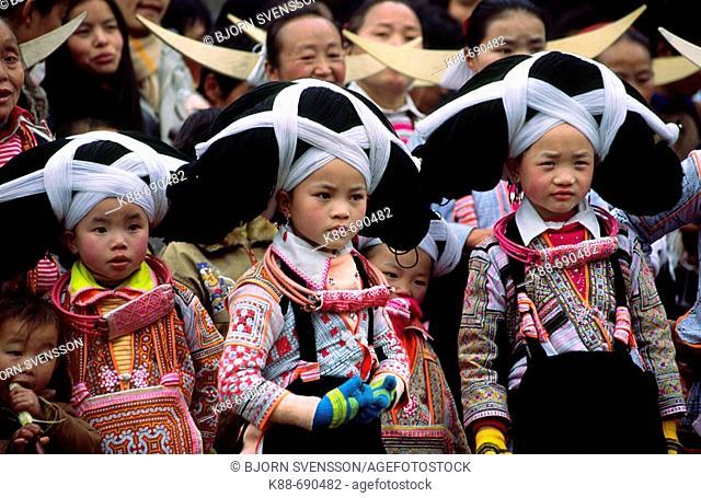Long horn Miao girls during New year celebrations, Guizhou, China
