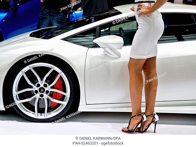 A Model stands by the new Lamborghini Huracan LP 610-4 during the Paris Motor Show (Mondial de l'Automobile) in Paris, France, 2 October 2014