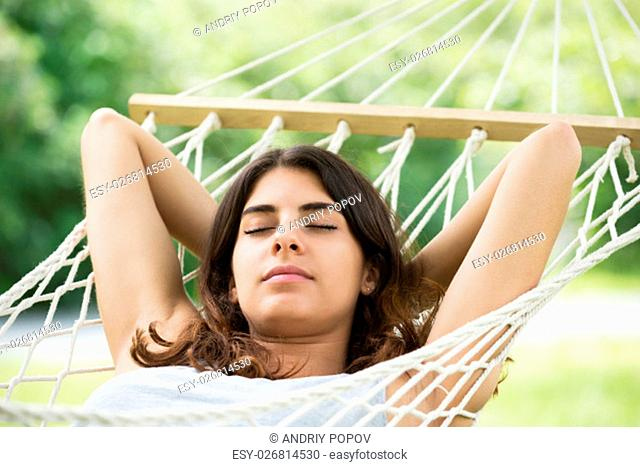 Close-up Of Young Woman Lying In Hammock
