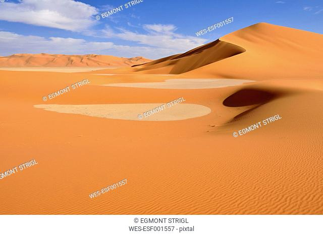 Africa, Algeria, Sahara, Tassili N'Ajjer National Park, Tadrart region, sand dunes and clay pan of southern Oued in Tehak