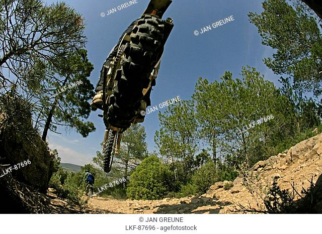 Person driving offroad with Motocross motorbikes, Suzuki Offroad Camp, Valencia, Spain