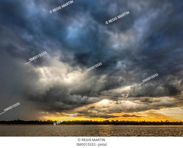 Stormy sky at sunset over the Daly River in the Northern Territory of Australia