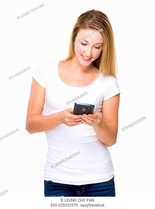 Young woman check the message on cellphone