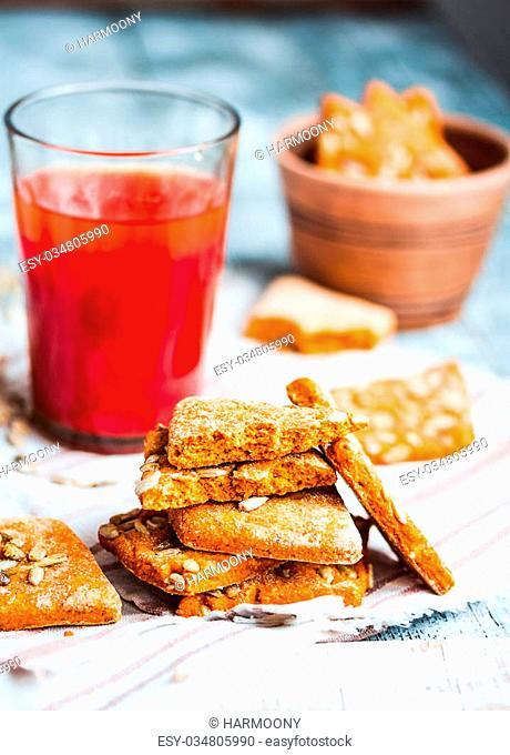 vegan biscuits with tomato juice and sunflower seeds, healthy dessert, close-up