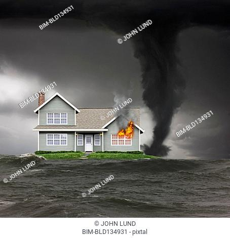 Burning house on isolated island in stormy seas