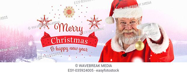 Merry Christmas Happy New Year text and Santa Claus in Winter with Christmas bauble decoration
