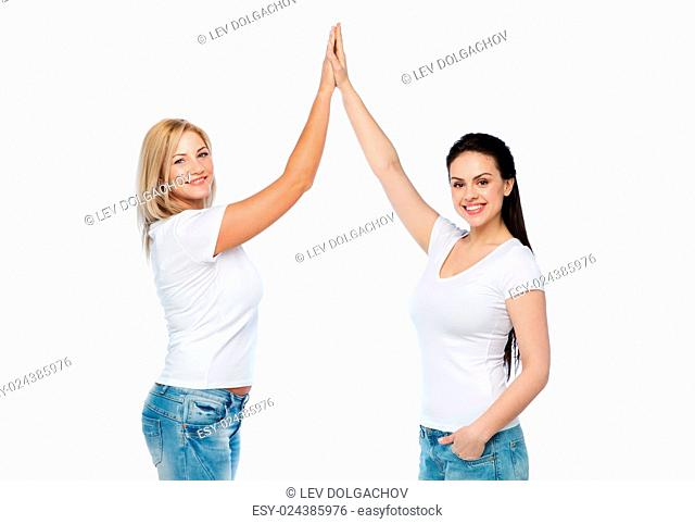 friendship, diverse, body positive, gesture and people concept - group of happy different women in white t-shirts making high five