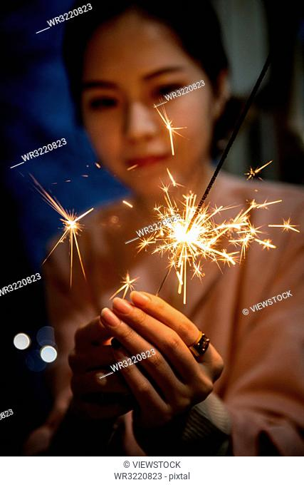 Young women with fireworks
