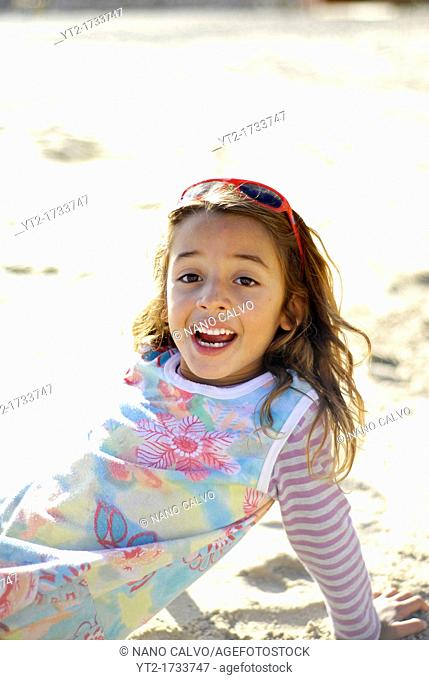 Cute brazilian seven year old girl on the beach