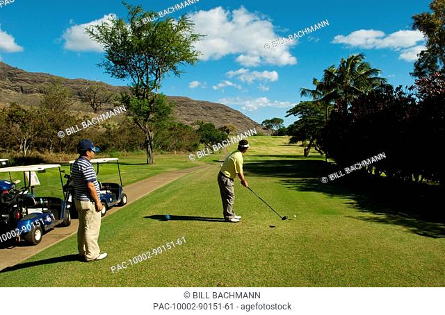 Hawaii, Oahu, Waianae, Makaha Resort, Two Japanese men play the 15th hole