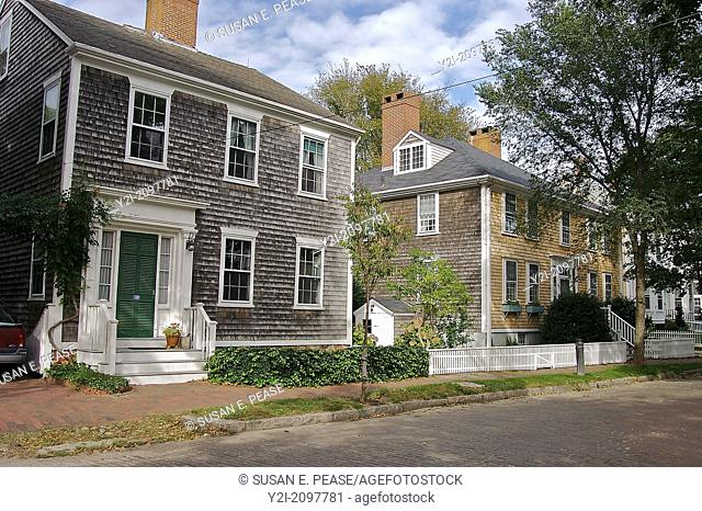 Old houses line a street on Nantucket, Massachusetts, United States