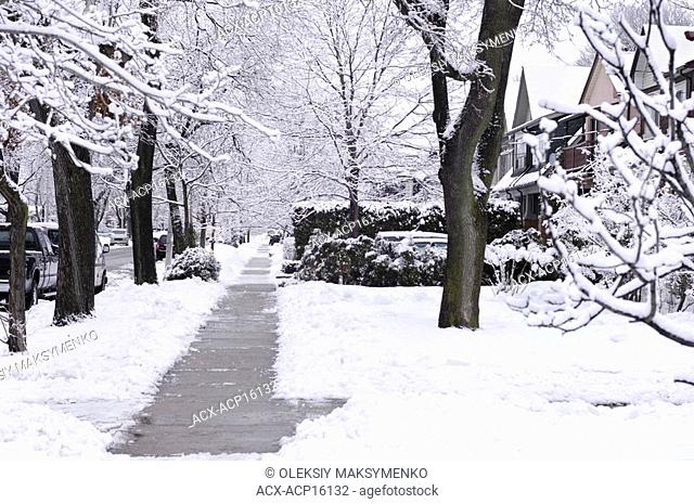 Sidewalk on a street covered with snow wintertime scenic Toronto Ontario Canada