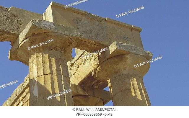 Zoom back from close up of the Greek Doric Temple columns of the ruins of the Temple of Hera, Temple E, Selinunte, Sicily
