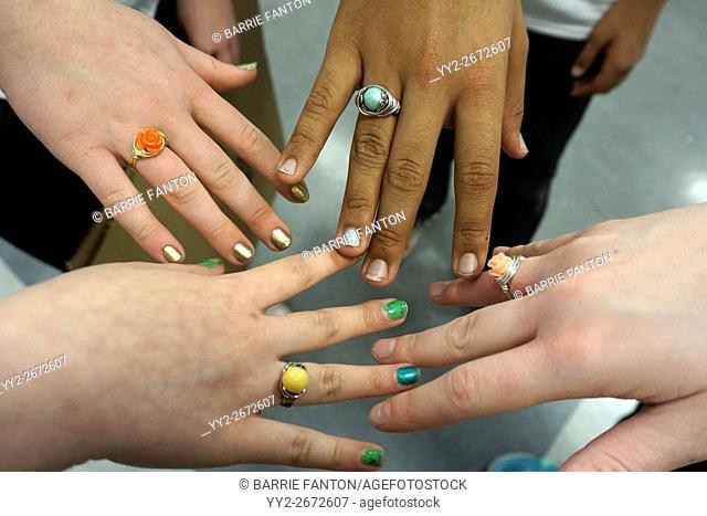 Teenagers' Hands with Handmade Rings, Wellsville, New York, USA