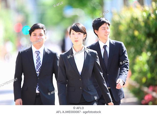 Young Japanese businessmen at city park