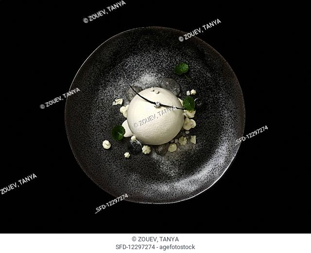 Fine dining pond in the forest white chocolate sphere