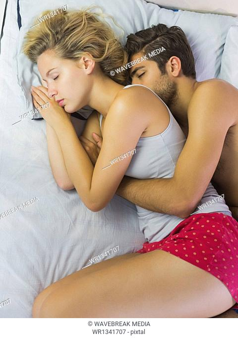 Cute couple spooning in bed