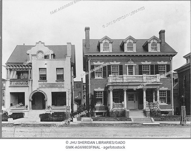 Facade of two homes on quiet street, with frontal porches and porches on second stories with chimneys, three stories each with basements