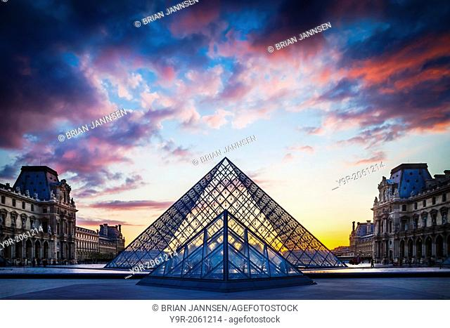 Courtyard of Musee du Louvre at sunset, Paris France