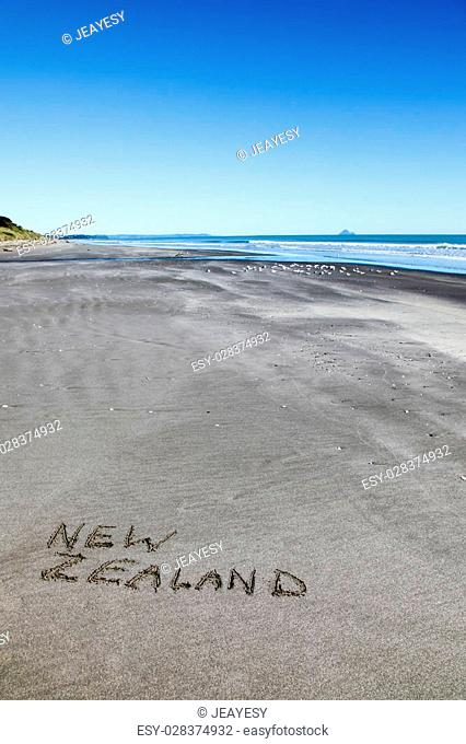 New Zealand written in the sand at the beach near Opotiki on the North Islands northern coastline