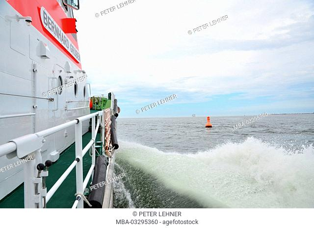 Germany, the North Sea, rescue lifeboat, bow wave, on deck