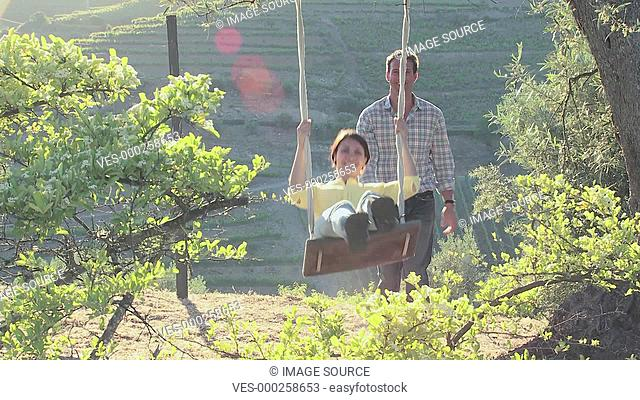 Couple on a swing on holiday