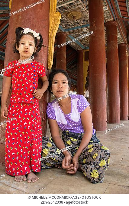 A young girl and her mother visit a local temple in Bagan