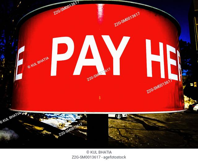 Pay here sign in a parking lot, Ontario, Canada
