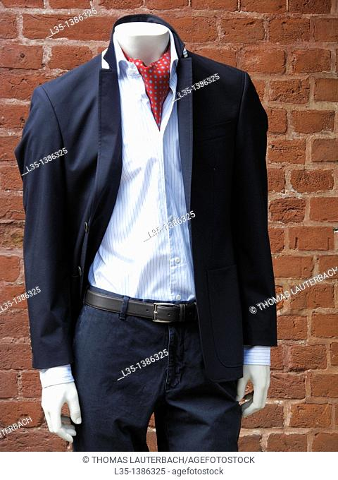 Male mannequin with no head in his suit