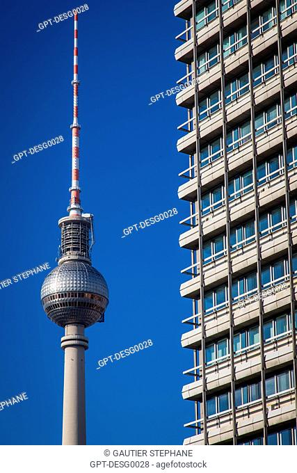 THE FERNSEHTURM TOWER ON ALEXANDERPLATZ EMITS TELEVISION SIGNALS. A PANORAMIC RESTAURANT IS SITUATED IN THE SPHERICAL PART, BERLIN, GERMANY
