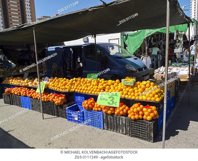 Oranges on display in the weekly market in Benidorm, Alicante Province, Spain