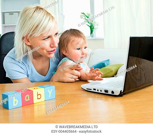 Young mother playing with her daughter