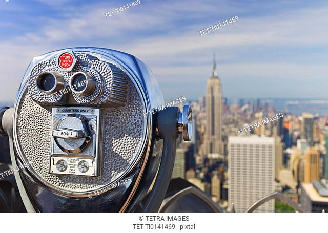 Coin operated binoculars looking out on New York City skyline