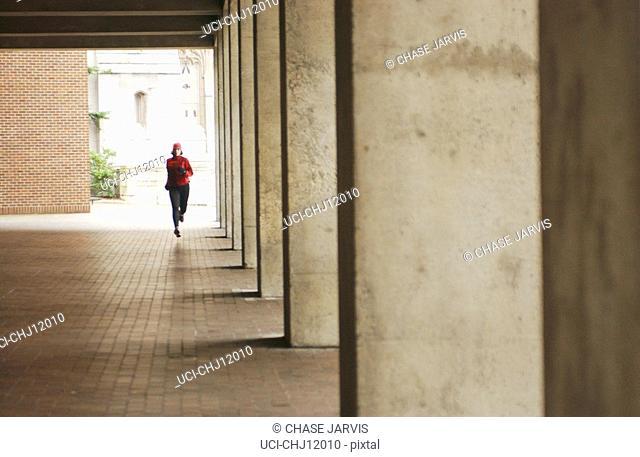 Woman running through pavilion