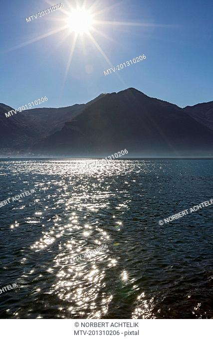 Scenic view of lake and silhouette of mountains
