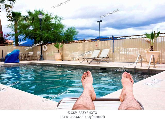 Man relaxing at the pool