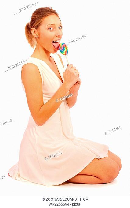 Girl licks sugar candy