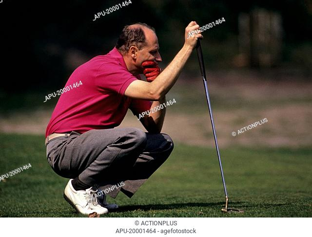 Golfer contemplates his shot