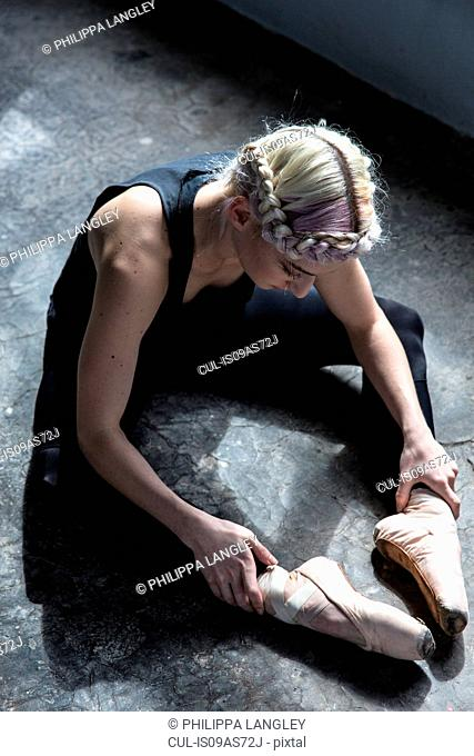 Dancer stretching in studio