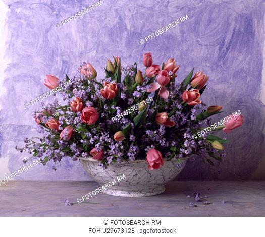 Still-life of pink roses and forget-me-nots in floral arrangement