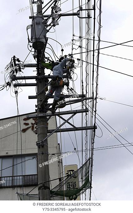 Electric worker fixing electricity mess, Takayama, Japan, Asia