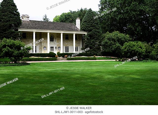 EXTERIORS: Lannonstone Colonial Revival, expansive lawns and manicured gardens in front of house angle view horizontal