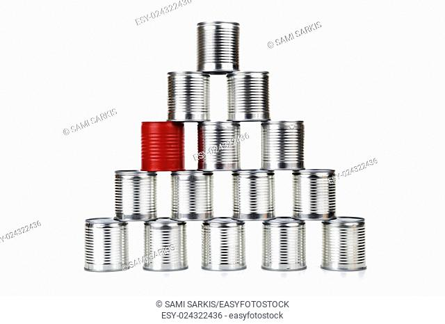 Red tin can inside a pyramid - difference concept
