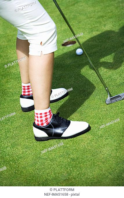 The legs of a person playing golf, Sweden