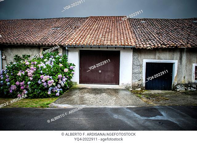 Garage of a village house with typical roof, a rainy day. Asturias. Spain