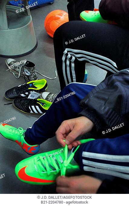 Trying football shoes