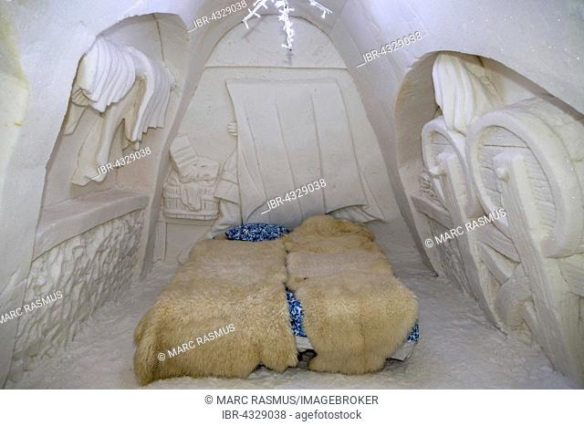 Bedroom with wall relief in the ice hotel, SnowCastle of Kemi, Lapland, Finland
